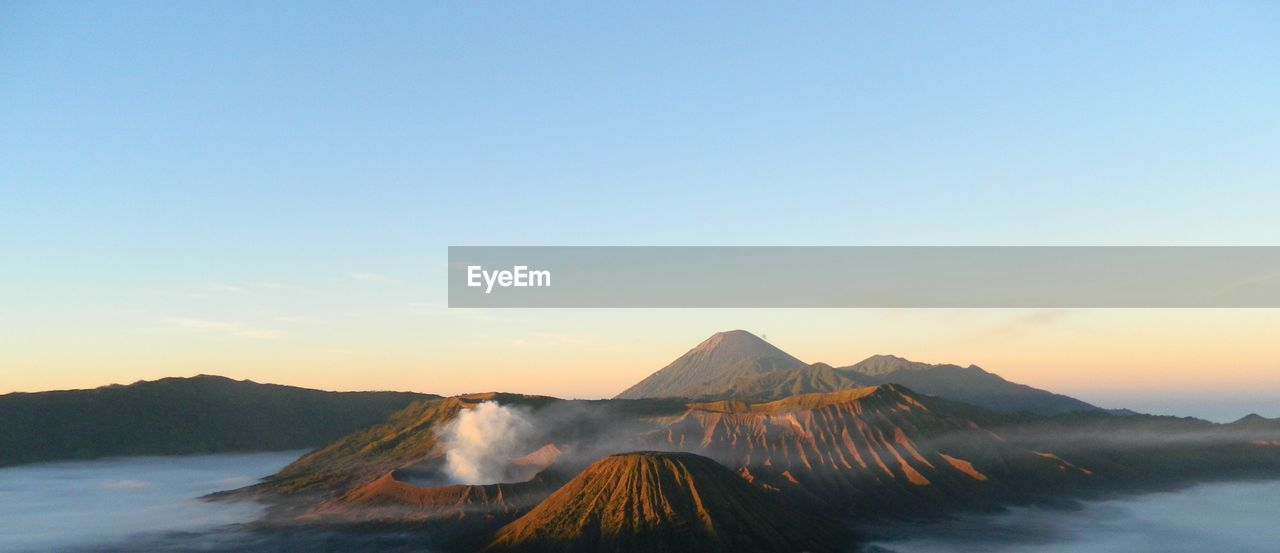 Scenic view of mount bromo against sky during sunrise