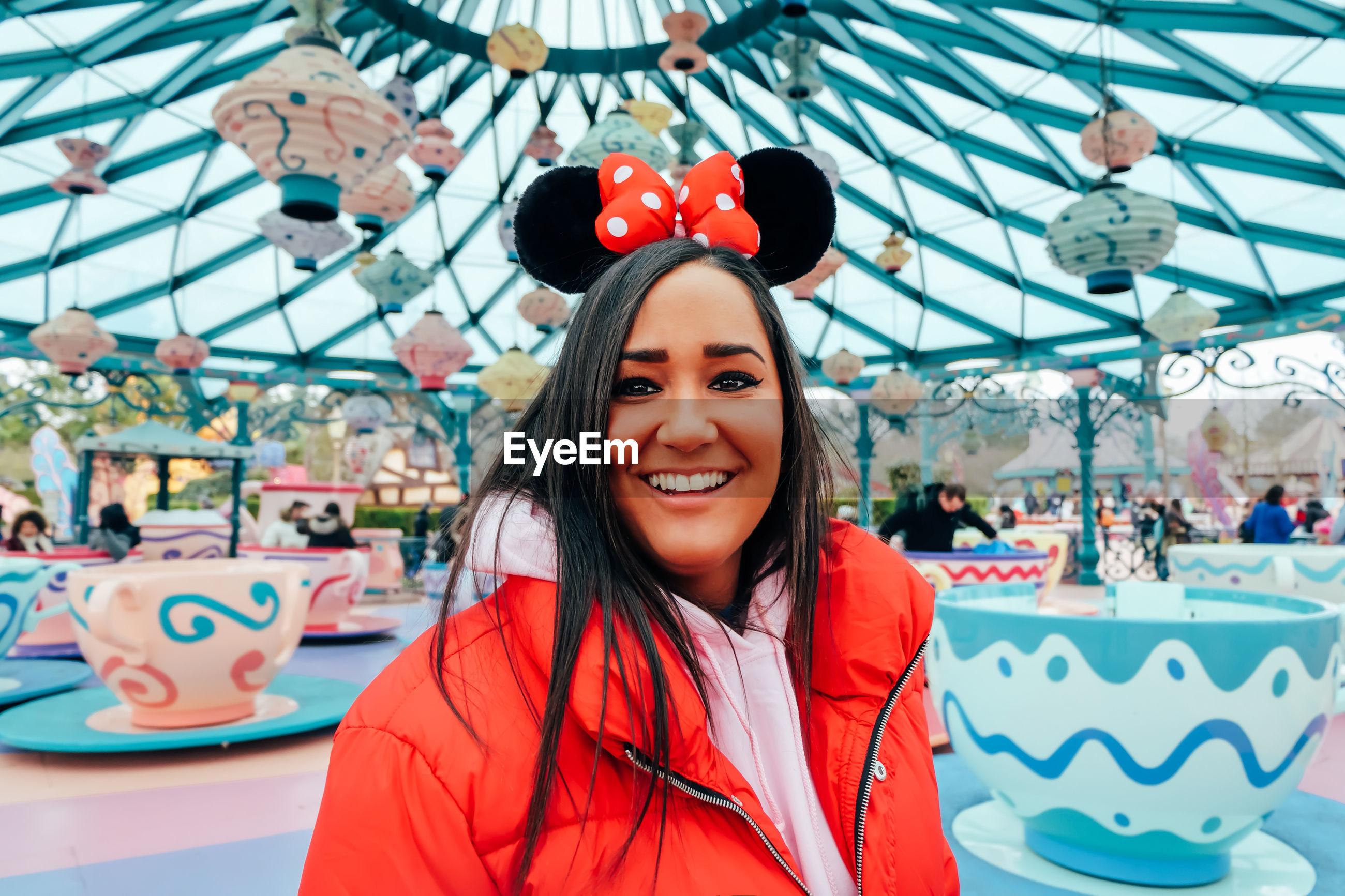 Portrait of smiling young woman at amusement park