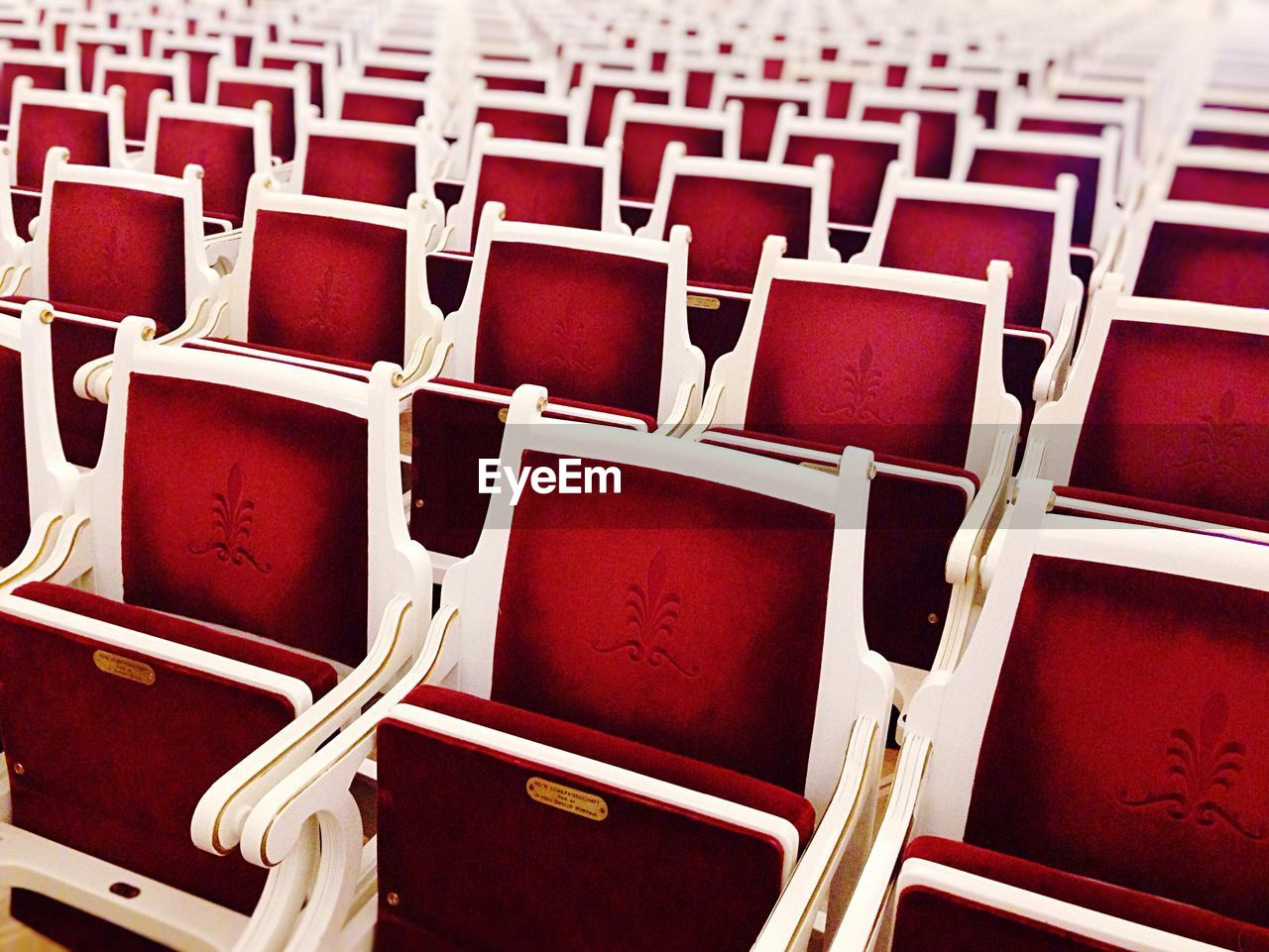 Full frame shot of red seats in concert hall