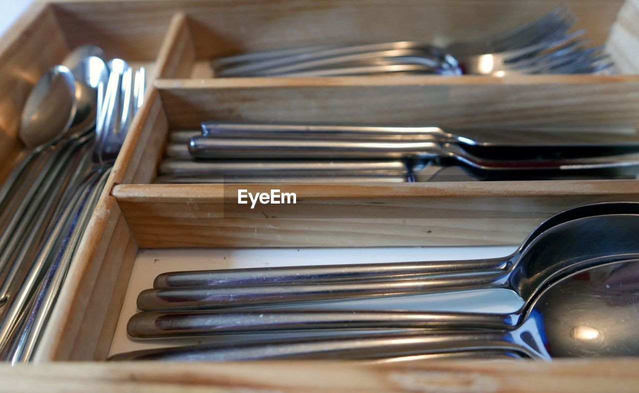 High angle view of cutlery in cabinet