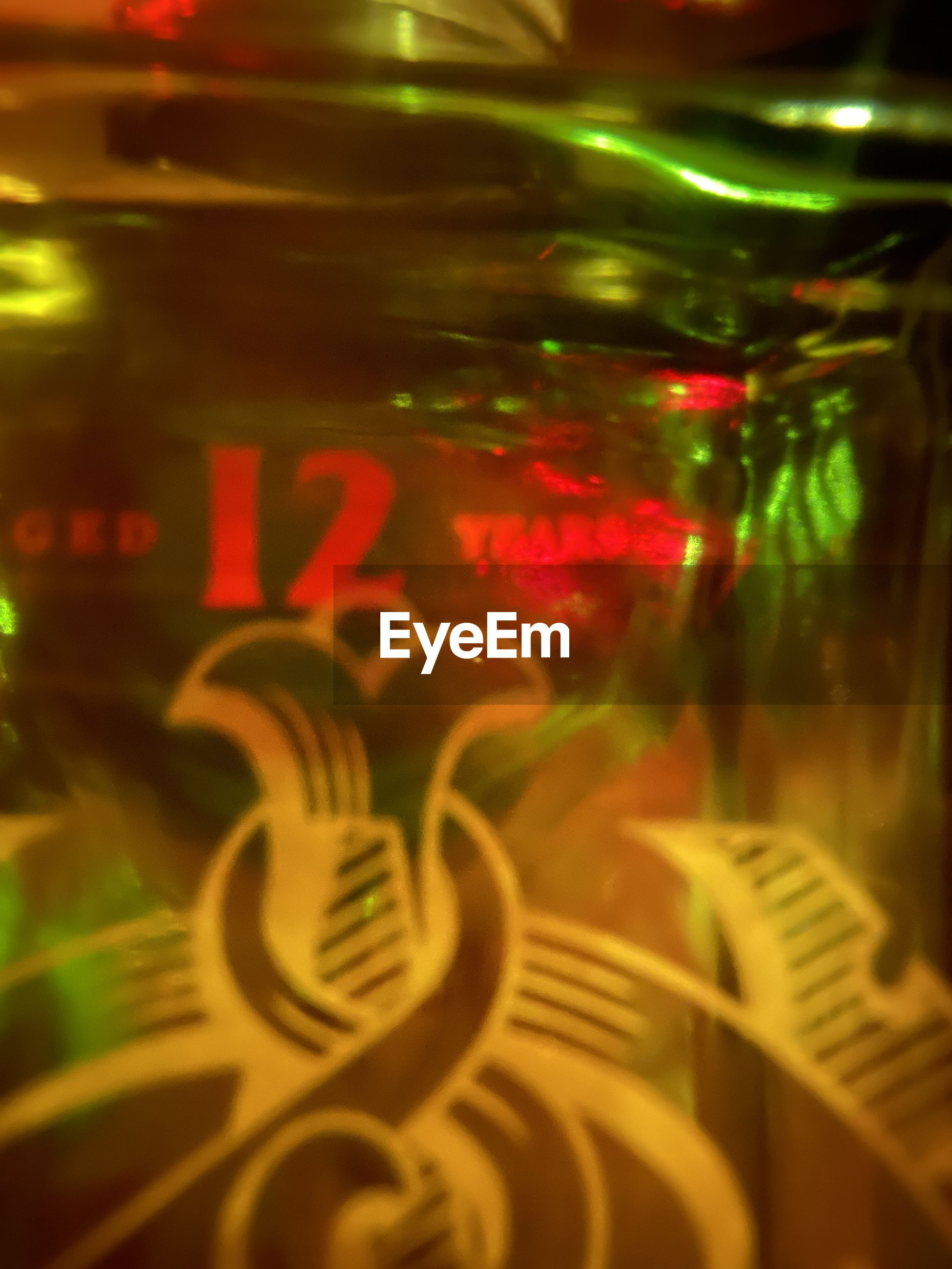 CLOSE-UP OF TEXT ON GLASS OF LIGHT BULB