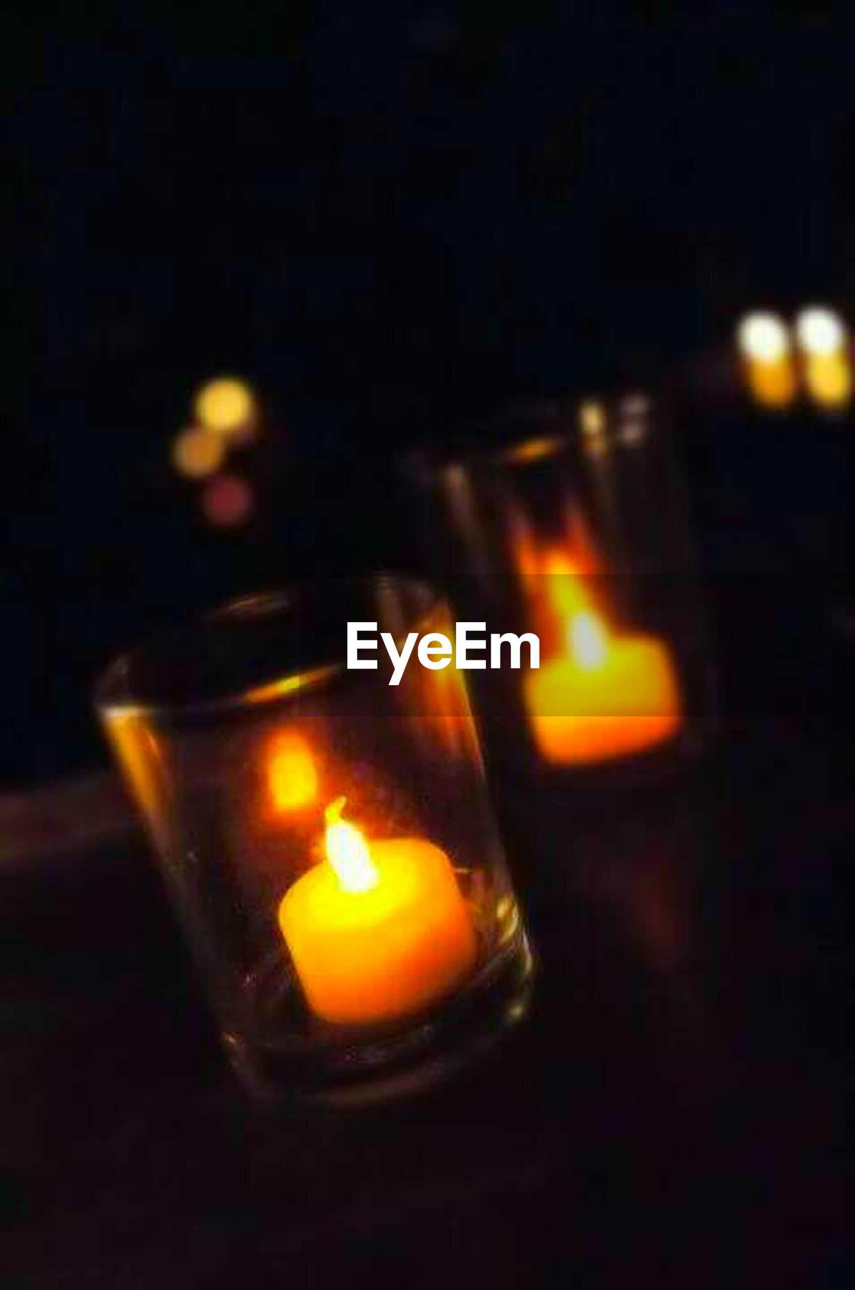 burning, flame, fire - natural phenomenon, illuminated, heat - temperature, glowing, candle, close-up, lit, light - natural phenomenon, in a row, candlelight, orange color, darkroom, fire, culture, no people, focus on foreground