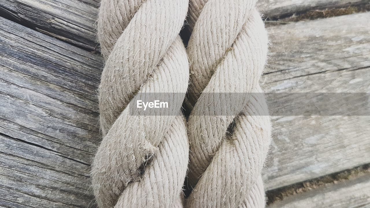 Close-Up High Angle View Of Rope On Wood