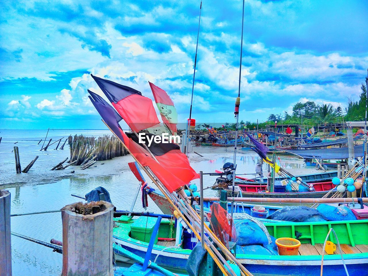 nautical vessel, sky, cloud - sky, transportation, mode of transportation, water, day, nature, moored, no people, blue, flag, outdoors, red, sea, beach, harbor, rope, travel, fishing boat