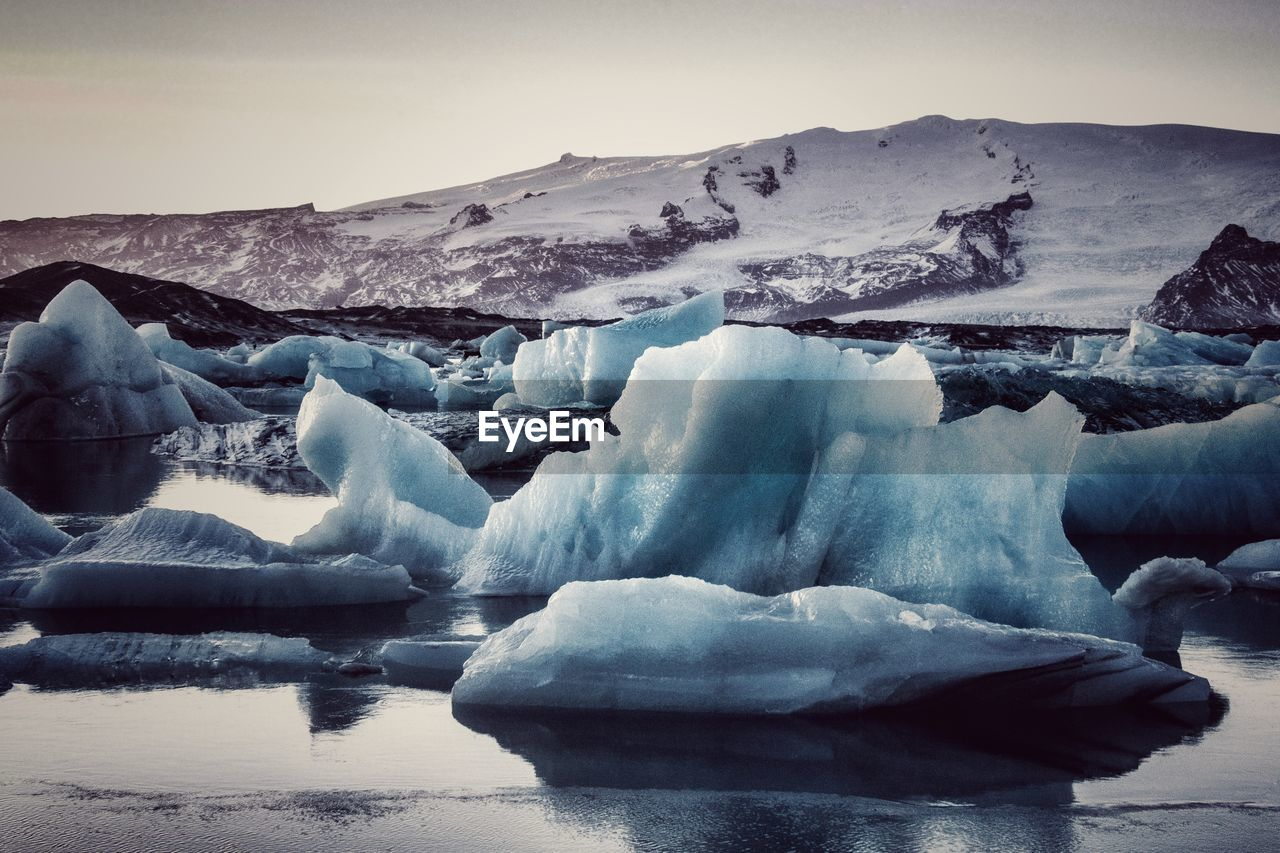 cold temperature, ice, water, winter, frozen, glacier, tranquil scene, environment, landscape, tranquility, iceberg, scenics - nature, sky, beauty in nature, nature, snow, day, no people, melting, floating on water, snowcapped mountain