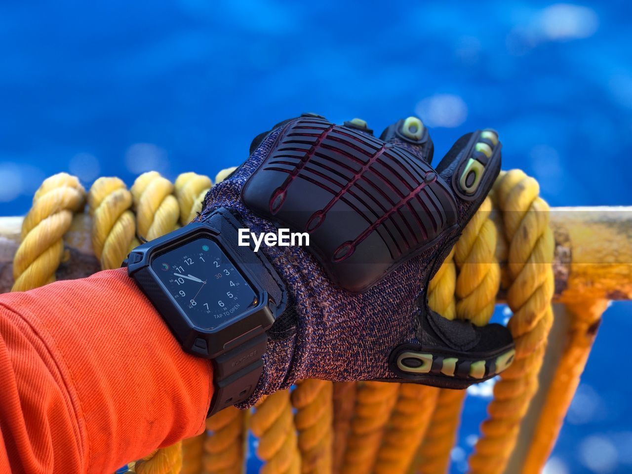 close-up, water, focus on foreground, blue, sport, rope, sea, glove, day, nature, equipment, sunlight, outdoors, one person, hand, strength, leisure activity, human hand, personal accessory