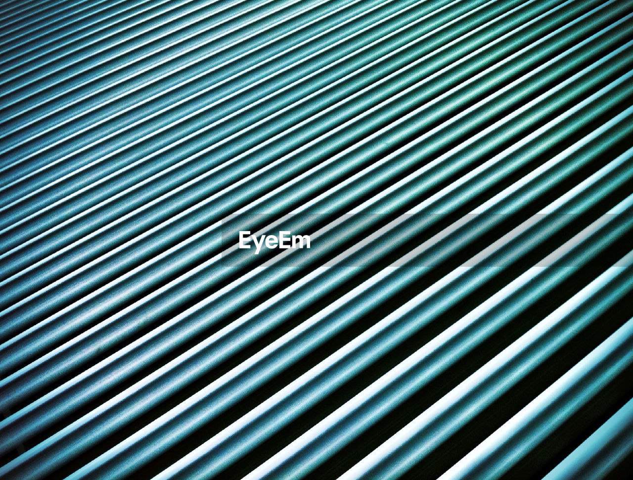 Full frame shot of blue metal rods