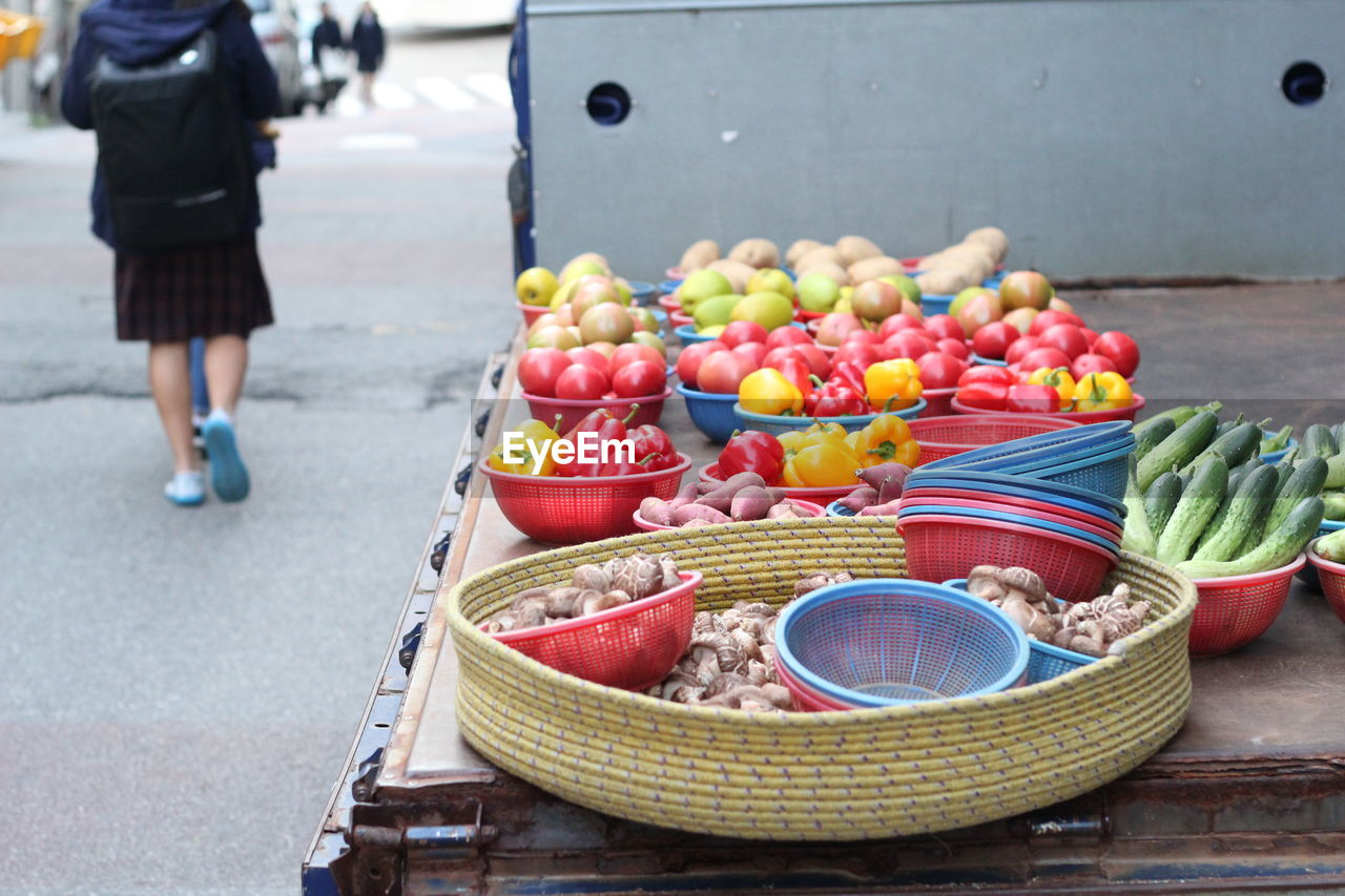 Fruits and vegetables in containers at market stall