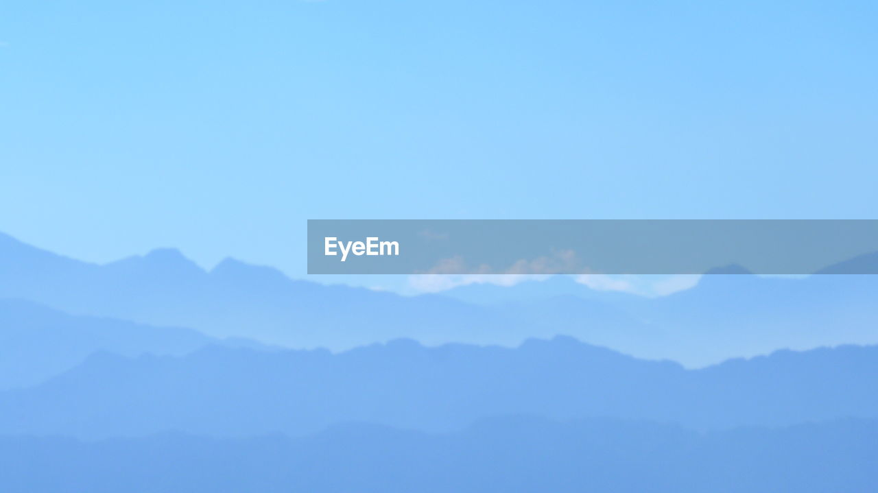 mountain, beauty in nature, sky, tranquility, scenics - nature, blue, tranquil scene, no people, copy space, nature, day, idyllic, mountain range, clear sky, outdoors, non-urban scene, majestic, environment, backgrounds, mountain peak
