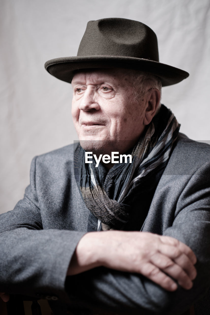 Senior man wearing hat looking away
