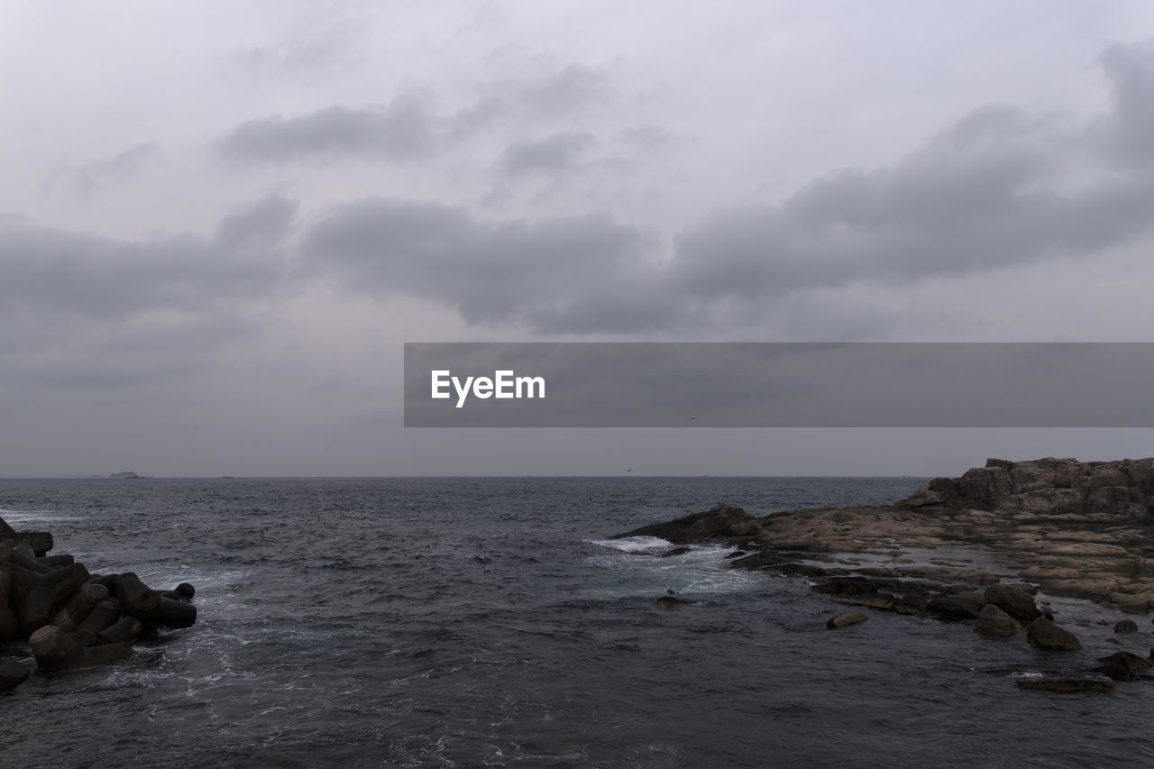 sea, sky, water, cloud - sky, scenics - nature, horizon over water, horizon, rock, beauty in nature, solid, rock - object, tranquility, tranquil scene, nature, no people, day, non-urban scene, waterfront, outdoors, rocky coastline