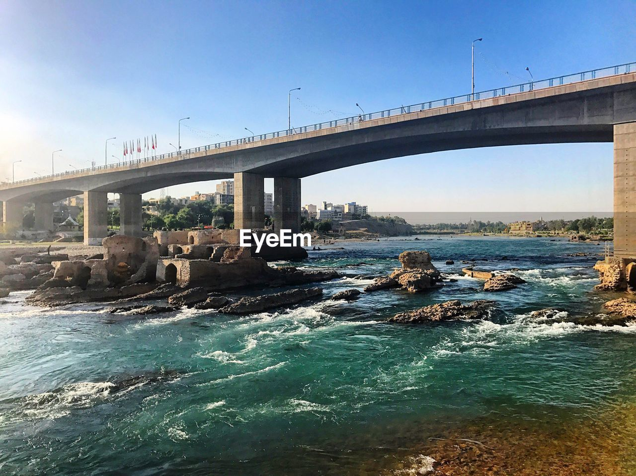 bridge - man made structure, connection, architecture, engineering, built structure, bridge, water, river, clear sky, transportation, nature, waterfront, day, outdoors, sky, below, sunlight, no people, underneath, under