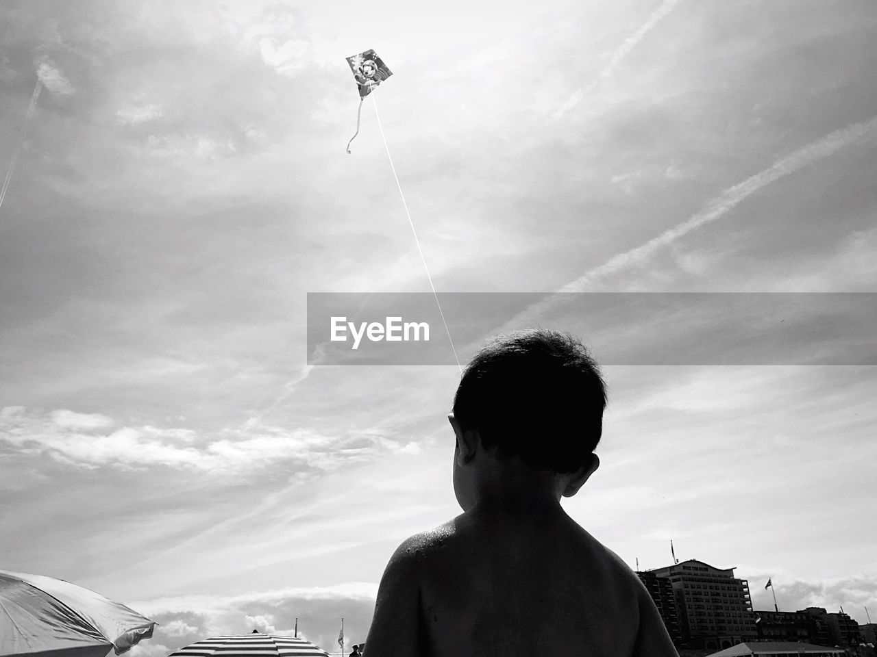 Low Angle View Of Boy Looking At Sky