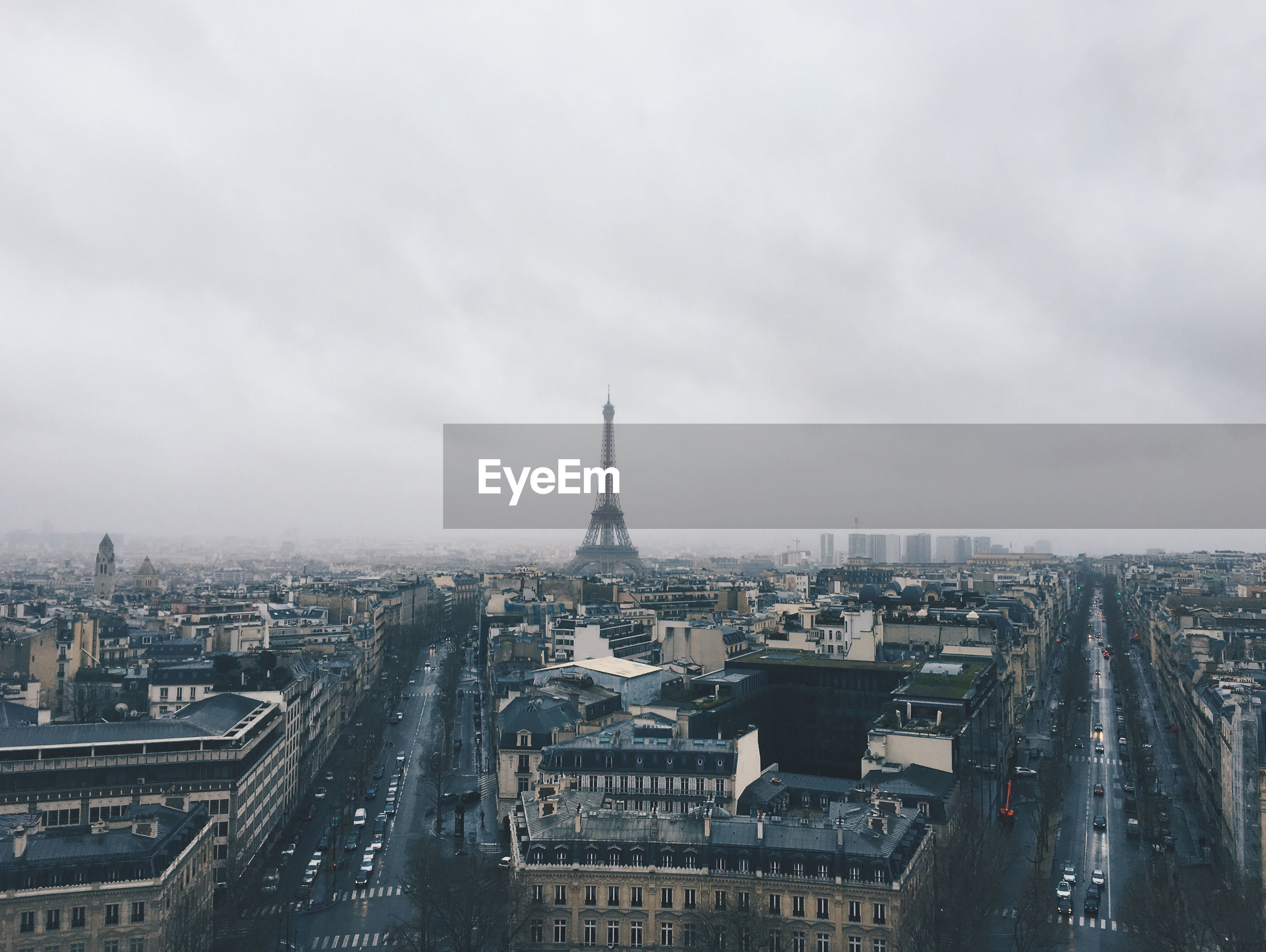 High angle view of cityscape with eiffel tower against sky