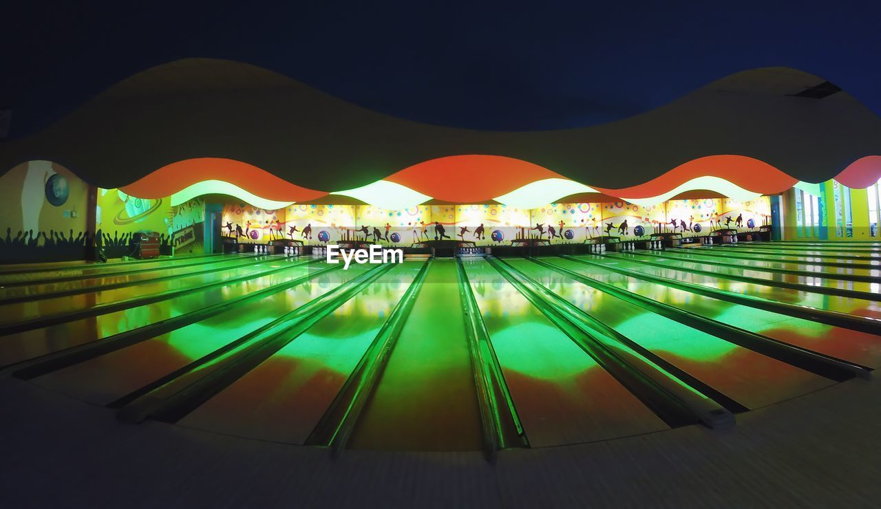 swimming pool, illuminated, built structure, water, architecture, reflection, night, building exterior, no people, outdoors, modern, city, sky
