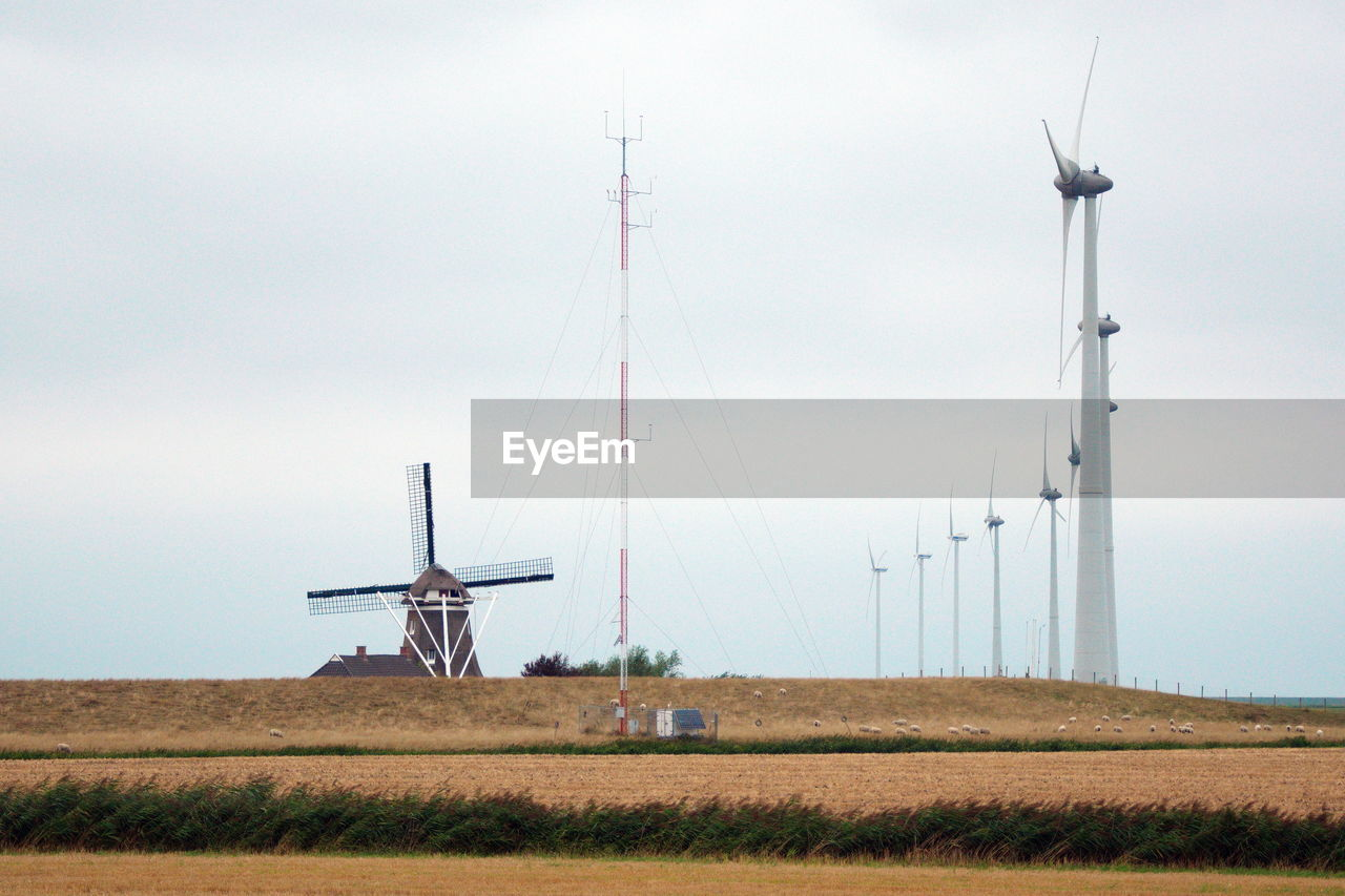 turbine, sky, wind turbine, environment, fuel and power generation, renewable energy, wind power, environmental conservation, alternative energy, nature, technology, field, no people, transportation, day, land, air vehicle, landscape, outdoors, rural scene
