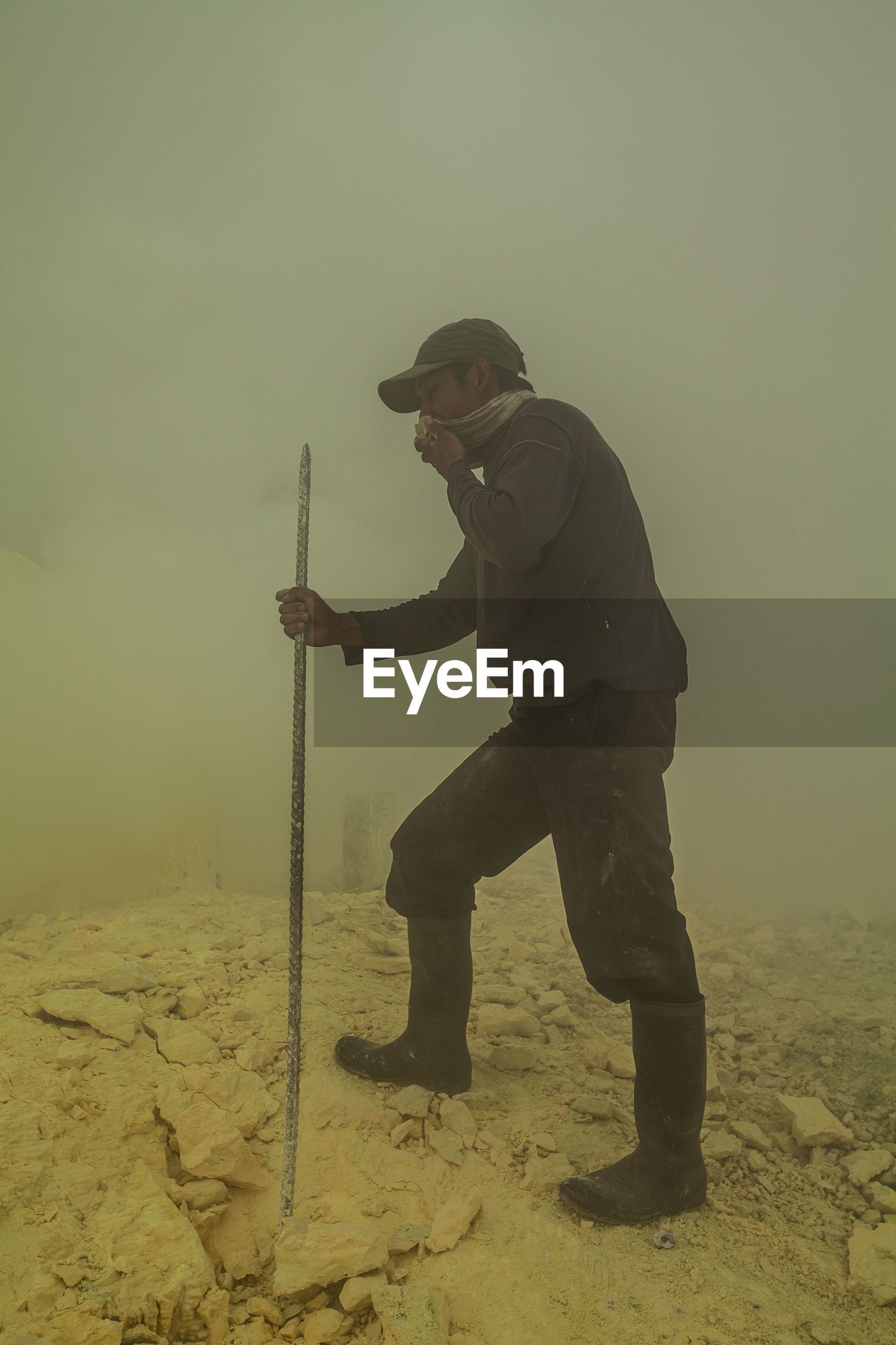 Manual worker on construction site in dusty environment
