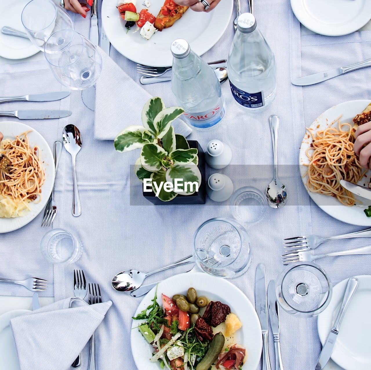 table, food and drink, plate, high angle view, fork, food, drinking glass, place setting, healthy eating, freshness, indoors, directly above, wineglass, no people, ready-to-eat, bowl, drink, dining table, serving size, vegetable, meal, day, alcohol