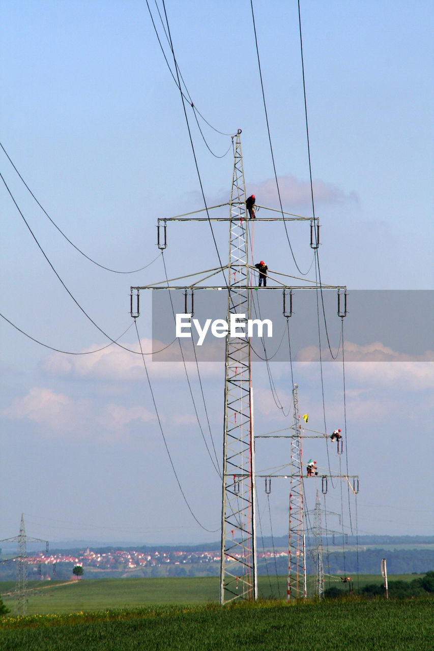 cable, electricity, sky, technology, fuel and power generation, power line, power supply, connection, electricity pylon, land, field, environment, nature, landscape, grass, no people, day, cloud - sky, outdoors, scenics - nature, complexity, electrical equipment, flock of birds, telephone line