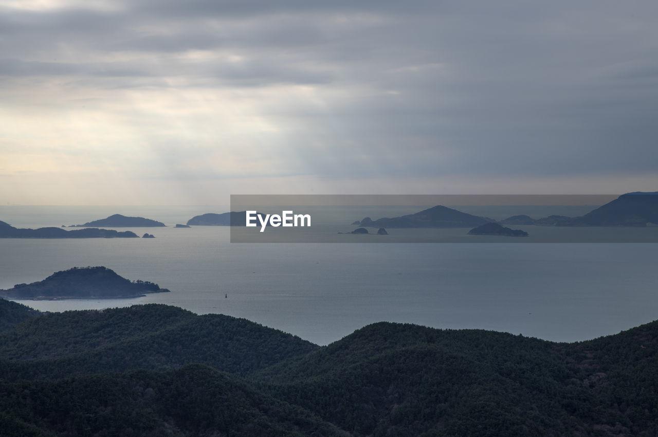 sky, scenics - nature, cloud - sky, mountain, beauty in nature, tranquil scene, tranquility, water, non-urban scene, nature, no people, mountain range, idyllic, environment, sea, day, fog, outdoors, mountain peak