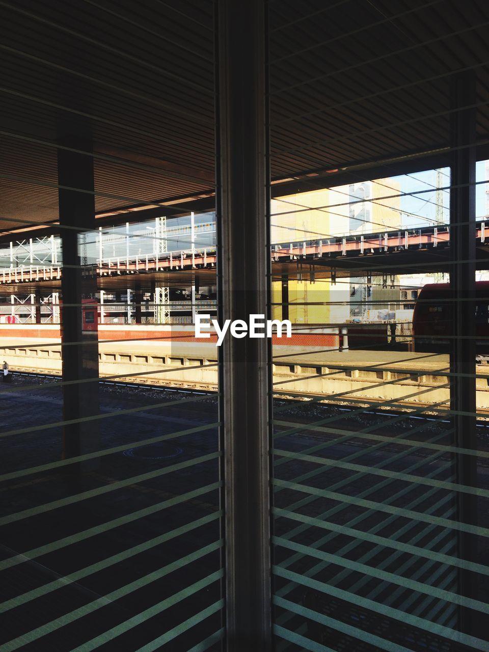 transportation, indoors, public transportation, architecture, railroad station platform, railroad station, built structure, window, day, rail transportation, no people