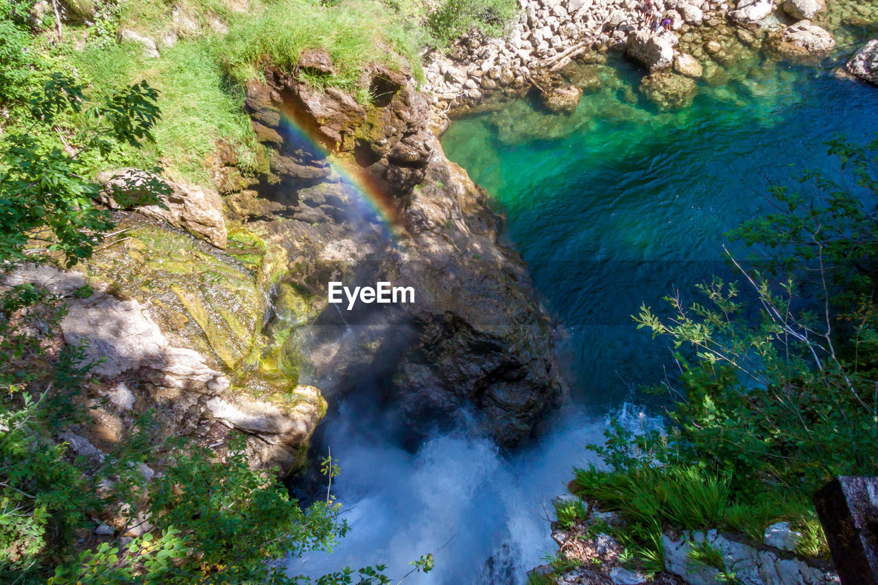 water, beauty in nature, high angle view, land, rock, nature, scenics - nature, no people, plant, smoke - physical structure, day, rock - object, tranquility, tranquil scene, solid, environment, outdoors, non-urban scene, tree, power in nature, pollution, turquoise colored