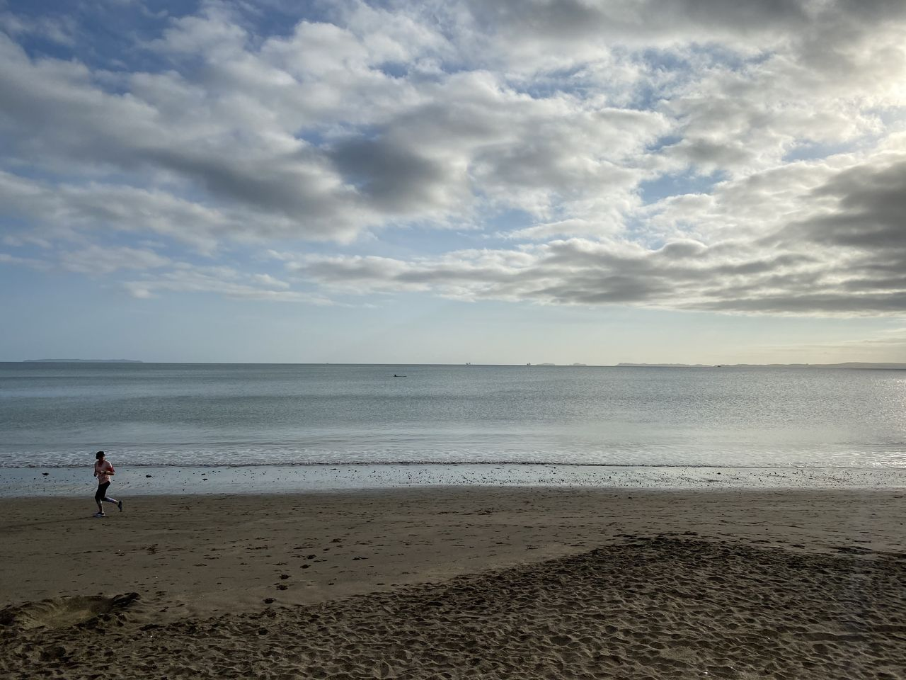 sea, beach, sky, cloud - sky, land, water, horizon, horizon over water, scenics - nature, beauty in nature, sand, real people, nature, tranquil scene, non-urban scene, tranquility, one person, leisure activity, outdoors