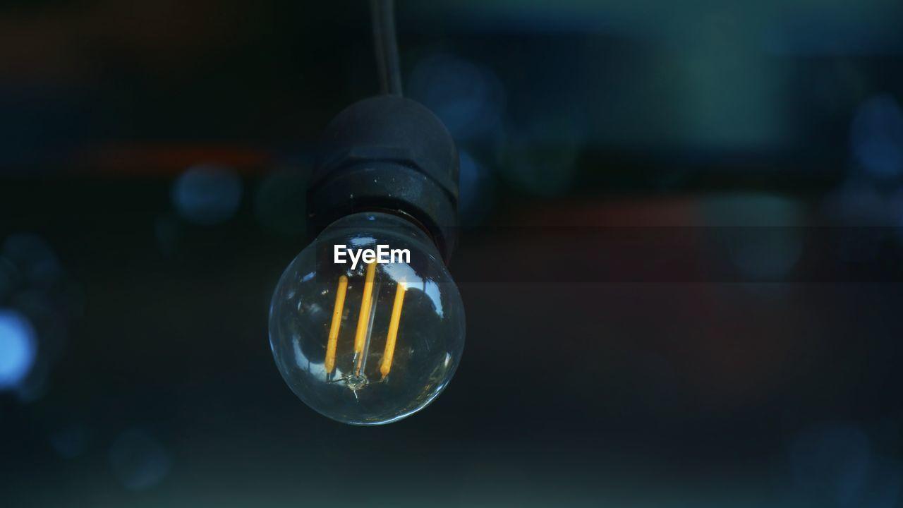CLOSE-UP OF ILLUMINATED LIGHT BULBS