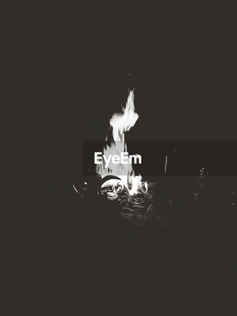 burning, flame, heat - temperature, copy space, night, no people, close-up, studio shot, indoors, illuminated, black background