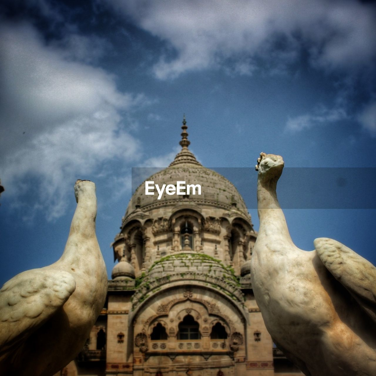 sky, cloud - sky, architecture, low angle view, built structure, travel destinations, building exterior, spirituality, outdoors, day, history, no people, statue, sculpture, place of worship
