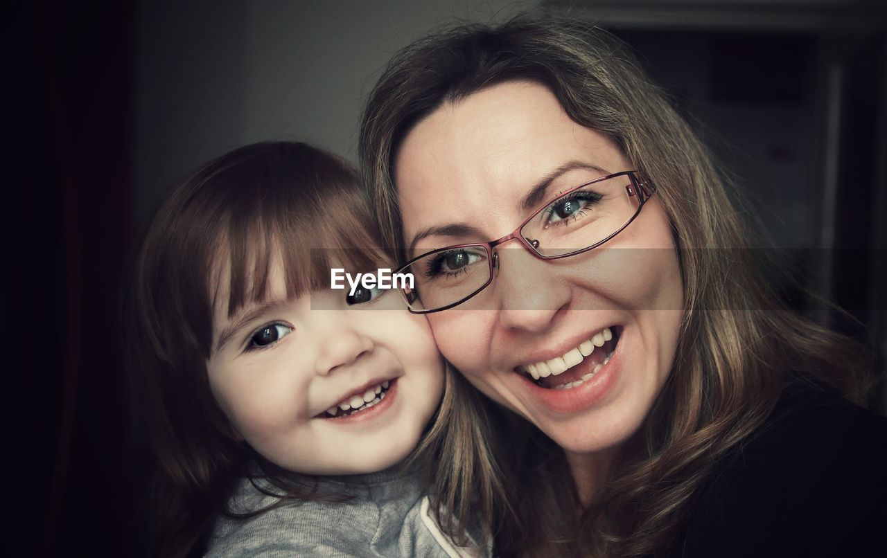 Close-up of happy woman with her daughter