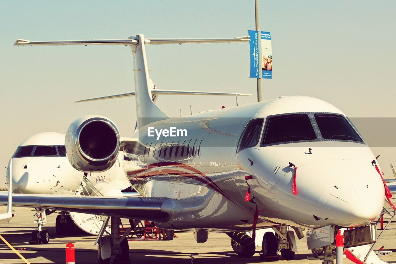 airplane, airport, air vehicle, transportation, commercial airplane, travel, airport runway, mode of transport, runway, day, jet engine, aircraft wing, outdoors, no people, private airplane, sky, airplane wing