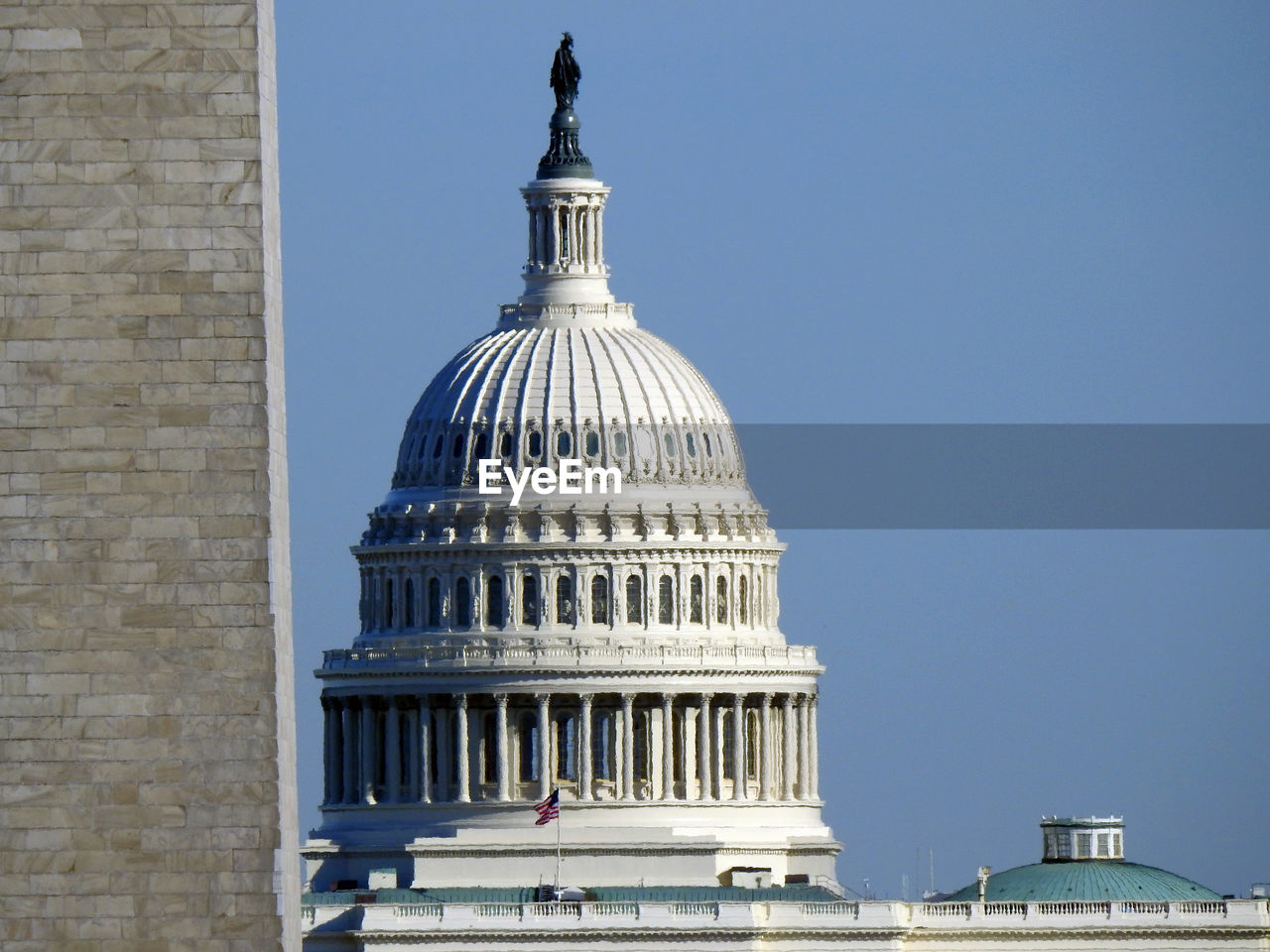 building exterior, dome, built structure, architecture, government, travel destinations, sky, city, no people, nature, day, clear sky, travel, flag, tourism, architectural column, patriotism, neo-classical