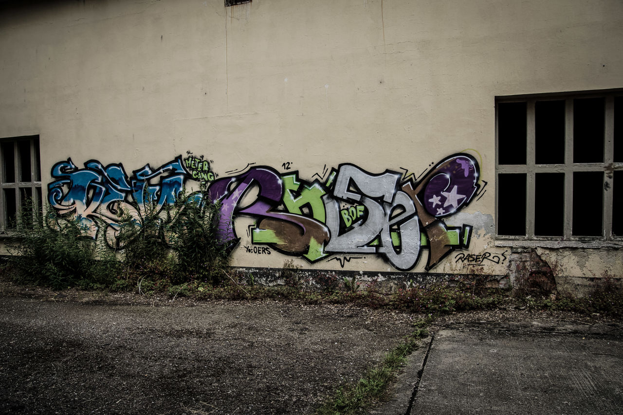 graffiti, wall - building feature, built structure, architecture, art and craft, creativity, no people, street art, building exterior, day, multi colored, wall, outdoors, footpath, abandoned, building, old, window, sidewalk, mural