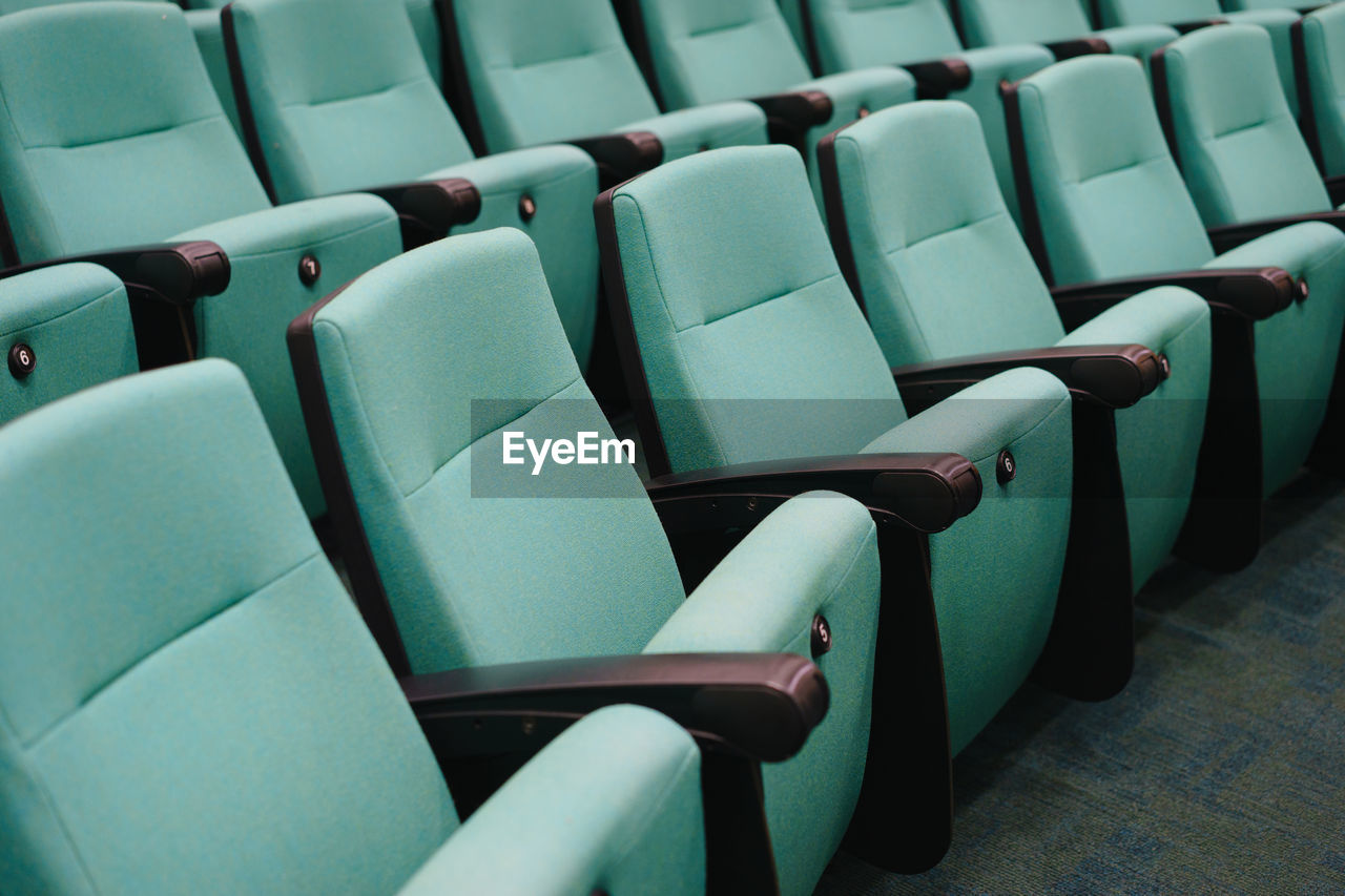 chair, in a row, indoors, seat, no people, auditorium, close-up, lecture hall, day