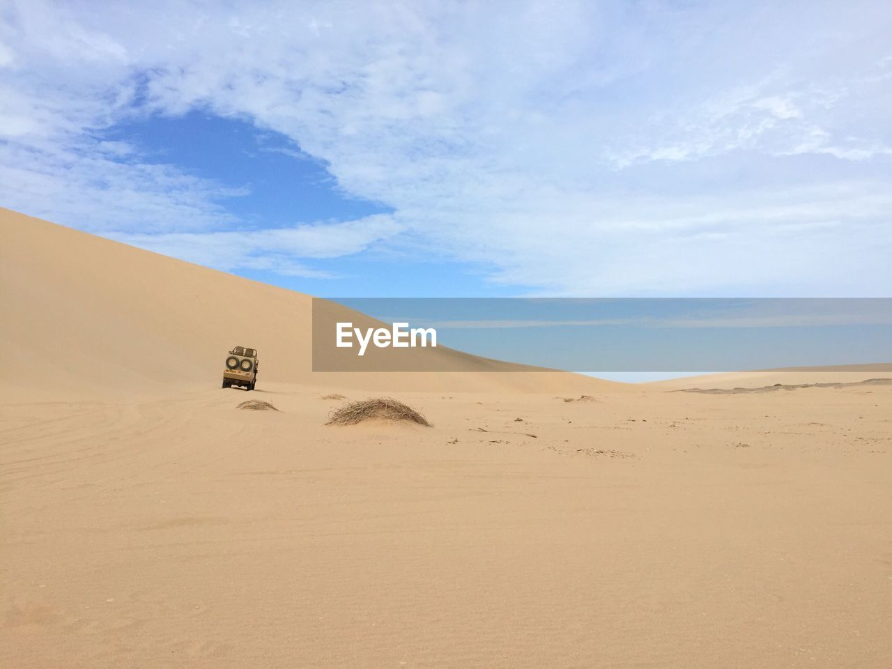 desert, land, sand, scenics - nature, sky, arid climate, climate, tranquil scene, landscape, tranquility, sand dune, cloud - sky, beauty in nature, environment, nature, non-urban scene, remote, day, no people, extreme terrain, outdoors