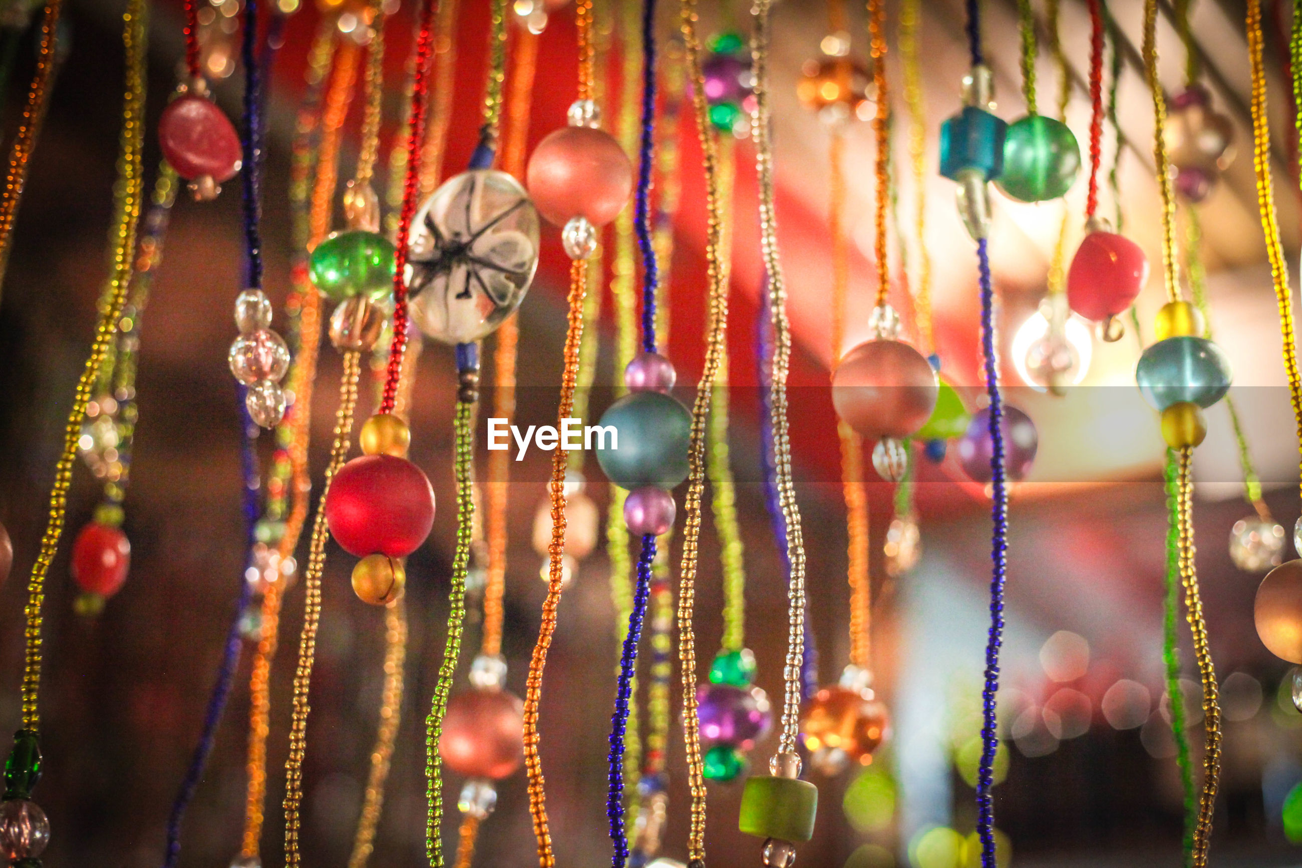 Close-up of decorations hanging in market stall