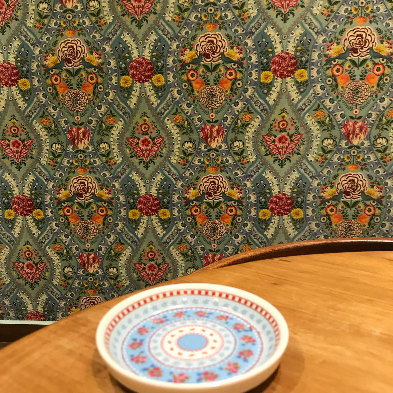 pattern, indoors, design, no people, table, multi colored, floral pattern, still life, wood - material, shape, close-up, art and craft, craft, flooring, high angle view, circle, geometric shape, plate, creativity