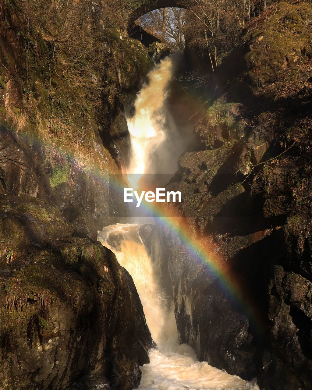 rainbow, scenics - nature, water, motion, waterfall, beauty in nature, flowing water, nature, no people, long exposure, power, rock formation, rock, rock - object, blurred motion, power in nature, non-urban scene, day, outdoors, flowing, double rainbow