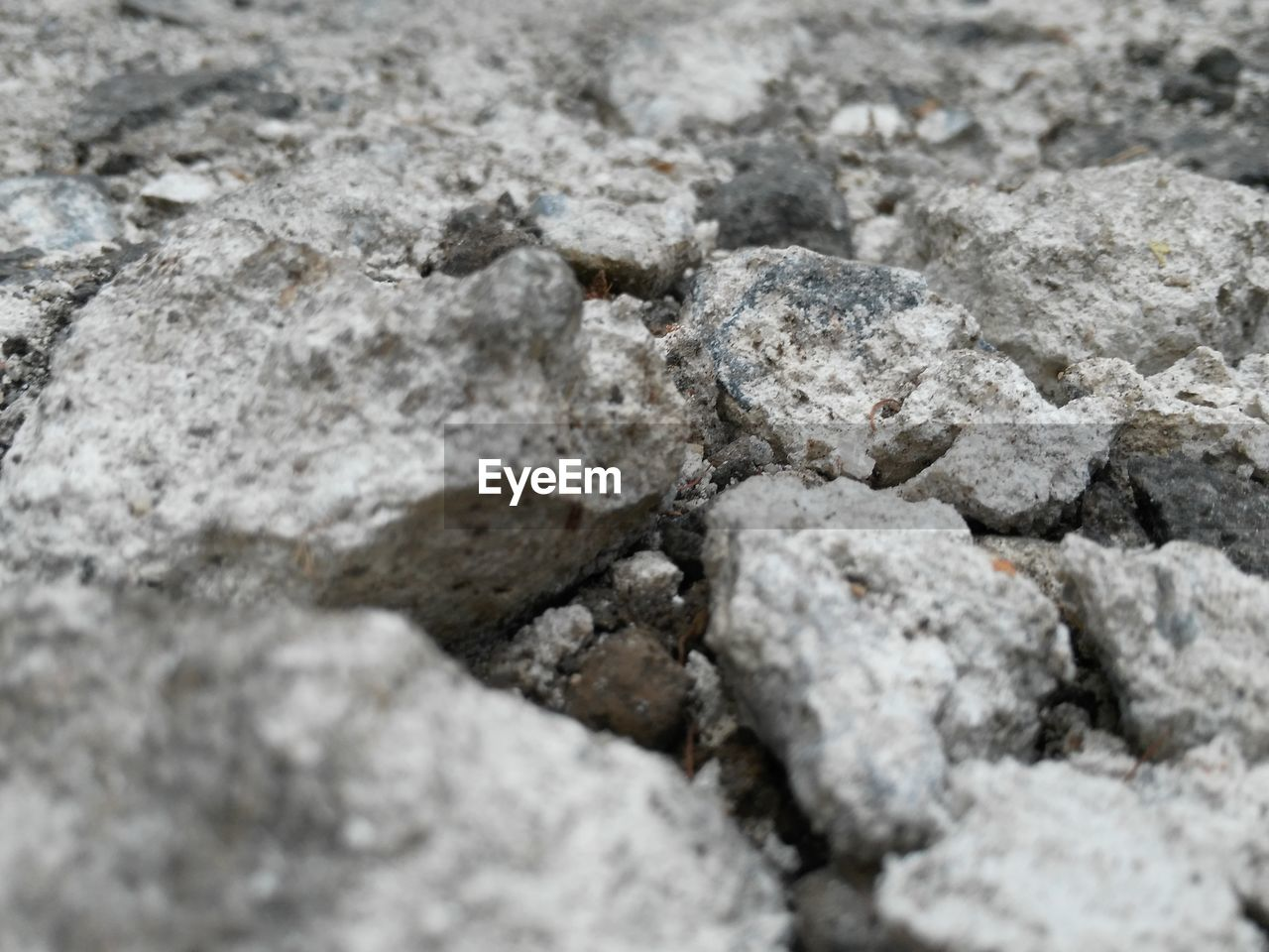 textured, full frame, backgrounds, no people, solid, selective focus, gray, rough, rock, close-up, rock - object, nature, day, outdoors, pattern, extreme close-up, stone - object, built structure, high angle view, construction material, textured effect, concrete