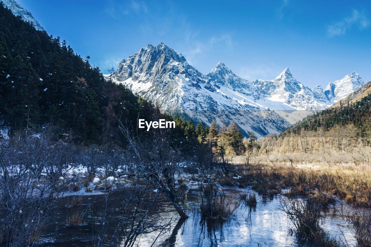 snow, mountain, cold temperature, winter, scenics, mountain range, nature, tranquil scene, beauty in nature, tranquility, snowcapped mountain, sky, day, non-urban scene, landscape, idyllic, lake, no people, outdoors, tree, water