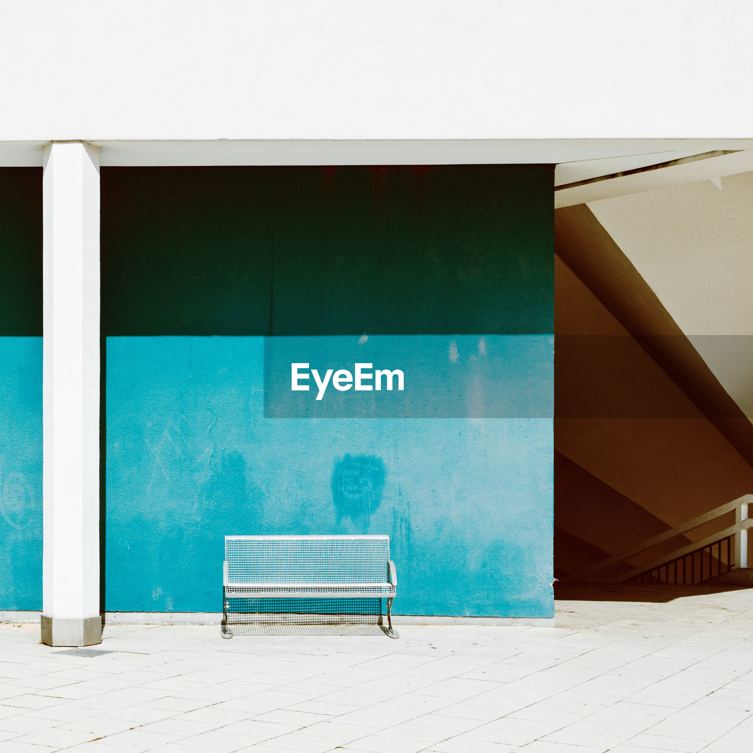 seat, architecture, chair, absence, empty, built structure, no people, day, wall - building feature, bench, blue, nature, sunlight, building exterior, outdoors, flooring, relaxation, footpath, railing, swimming pool, turquoise colored, luxury