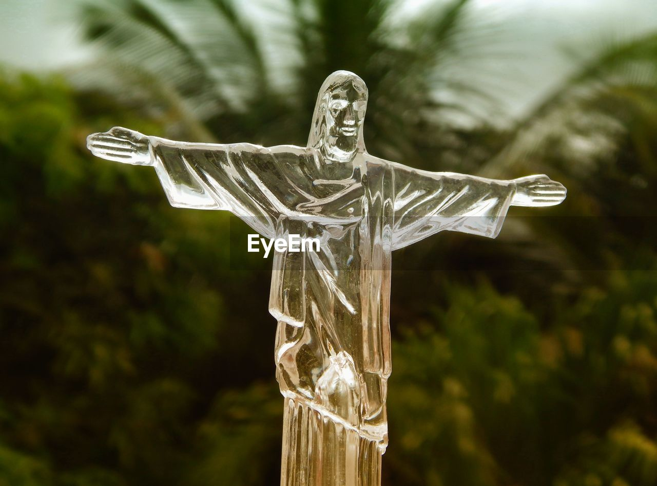 spirituality, religion, human representation, no people, statue, sculpture, cross, crucifix, focus on foreground, day, outdoors, place of worship, close-up, tree