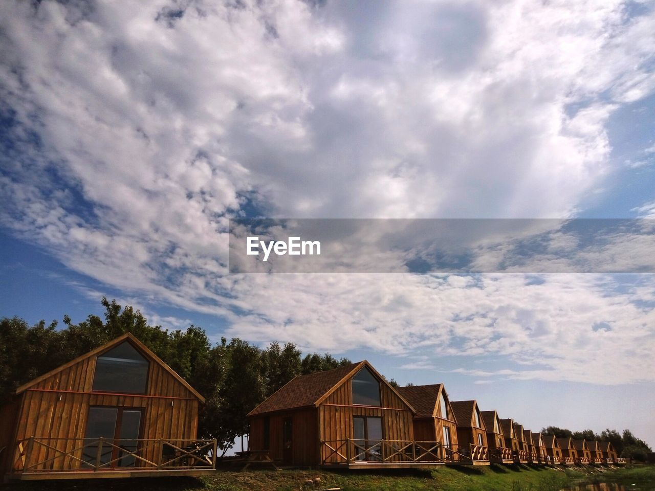 built structure, architecture, cloud - sky, sky, building, building exterior, house, residential district, nature, no people, day, plant, outdoors, tree, landscape, beauty in nature, rural scene, scenics - nature, low angle view, land, cottage, row house