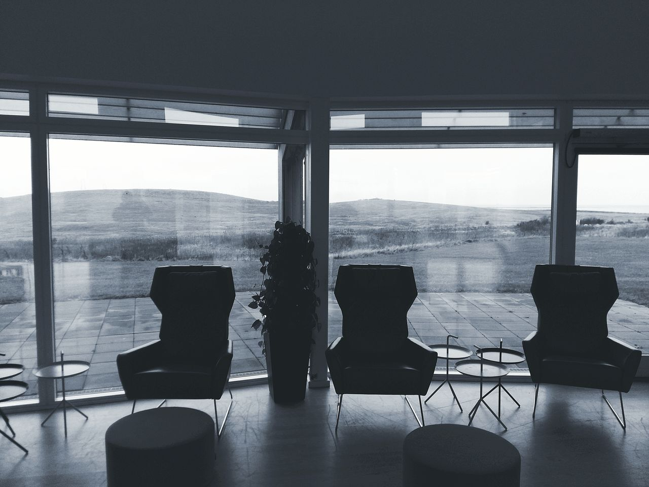 window, indoors, chair, empty, table, home interior, absence, no people, day, sofa, architecture, seat, home showcase interior, built structure, living room, sky