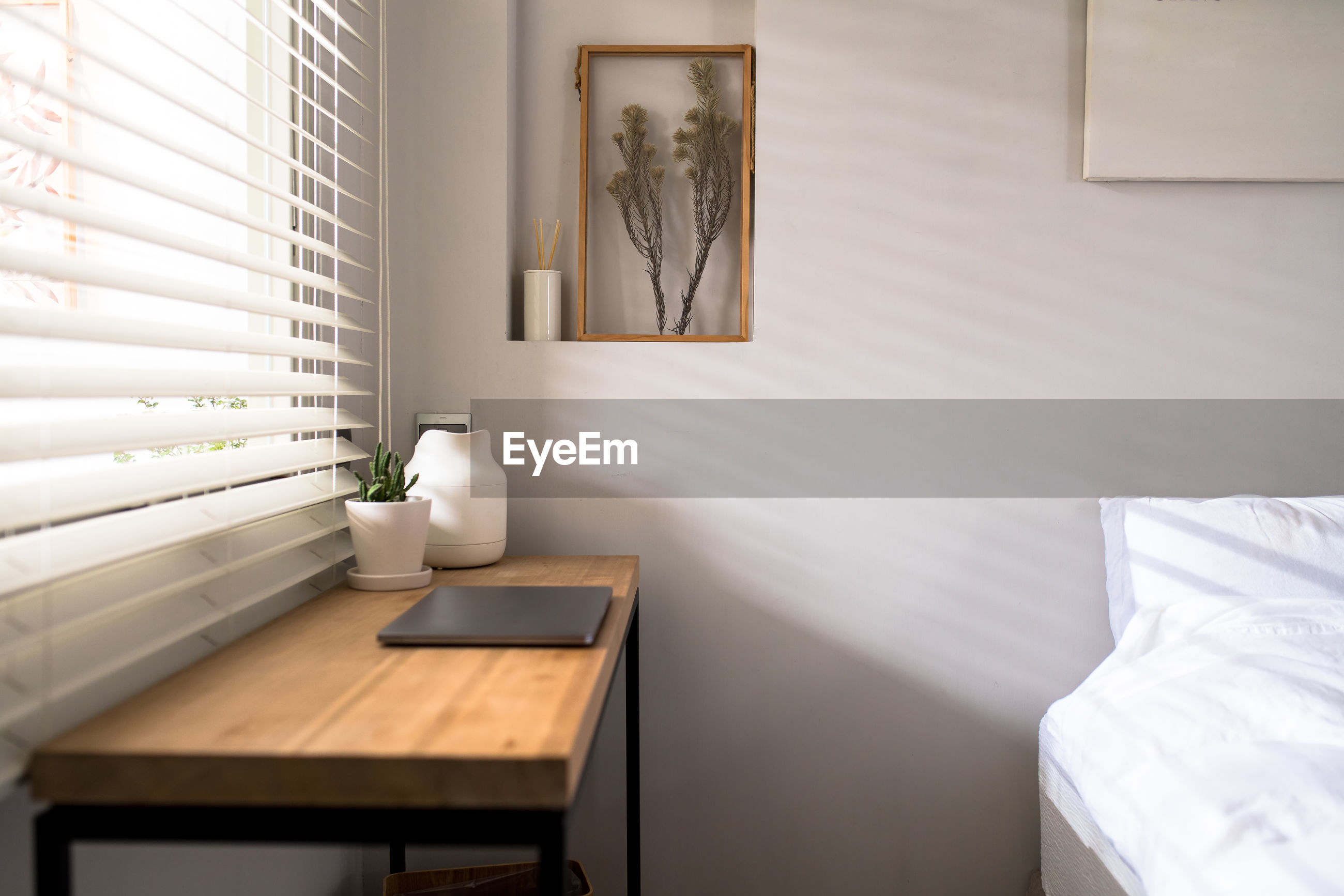 ELECTRIC LAMP ON TABLE BY WALL