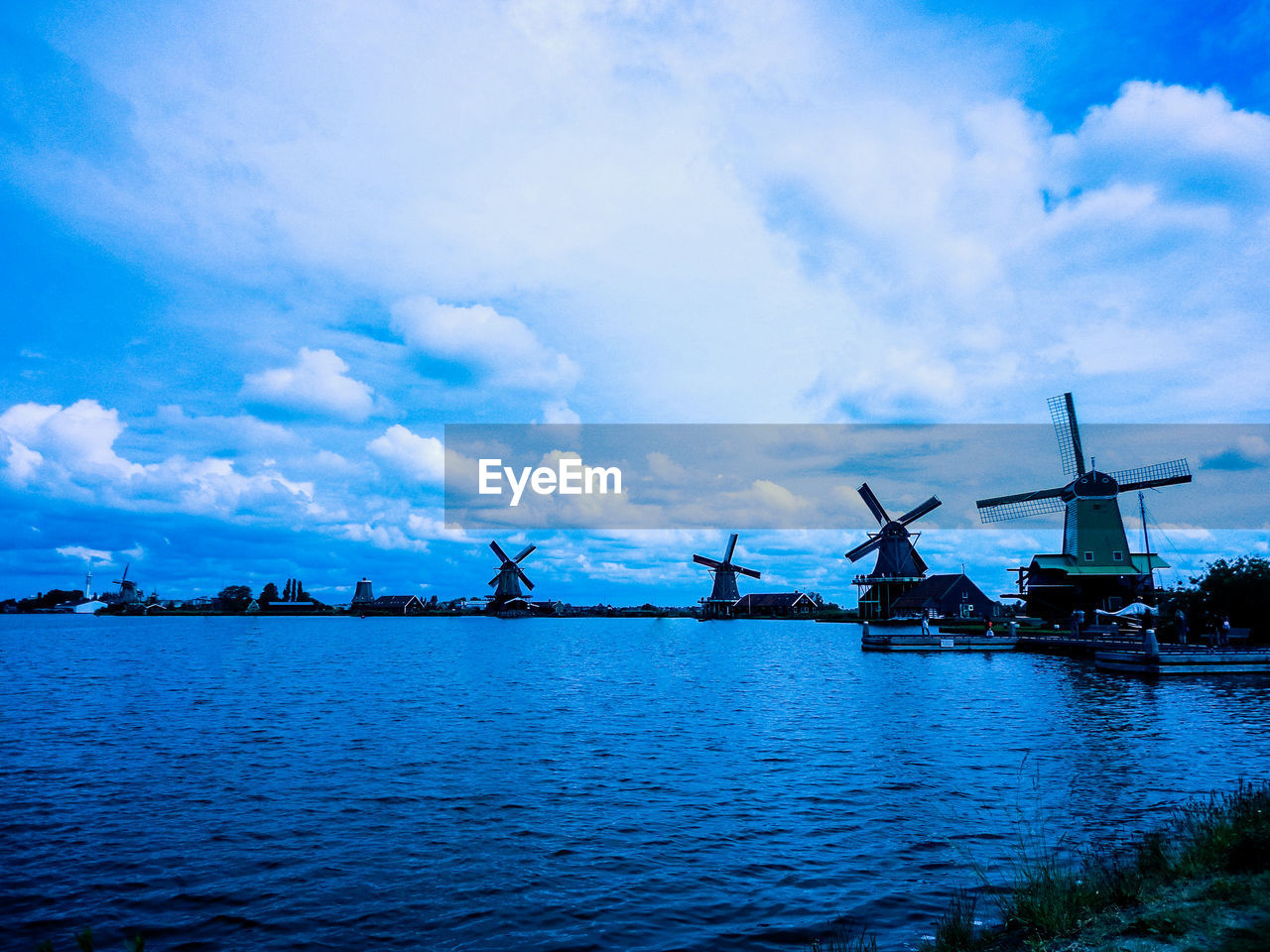 renewable energy, water, alternative energy, cloud - sky, sky, fuel and power generation, wind power, turbine, wind turbine, environmental conservation, waterfront, traditional windmill, environment, day, nature, beauty in nature, no people, architecture, built structure, outdoors