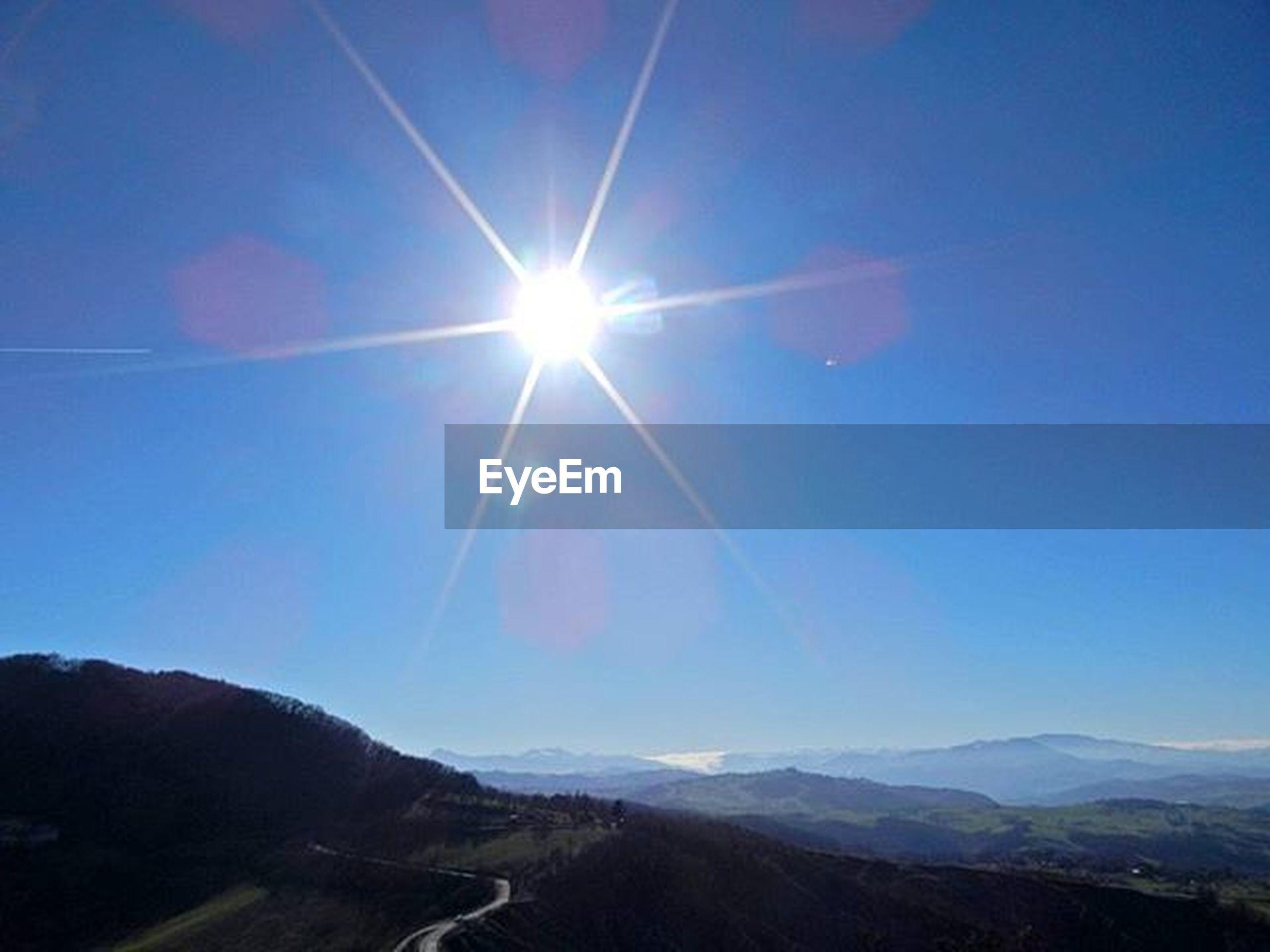 sun, mountain, sunbeam, sunlight, blue, tranquility, lens flare, tranquil scene, mountain range, scenics, landscape, beauty in nature, nature, sunny, sky, bright, clear sky, non-urban scene, day, snow