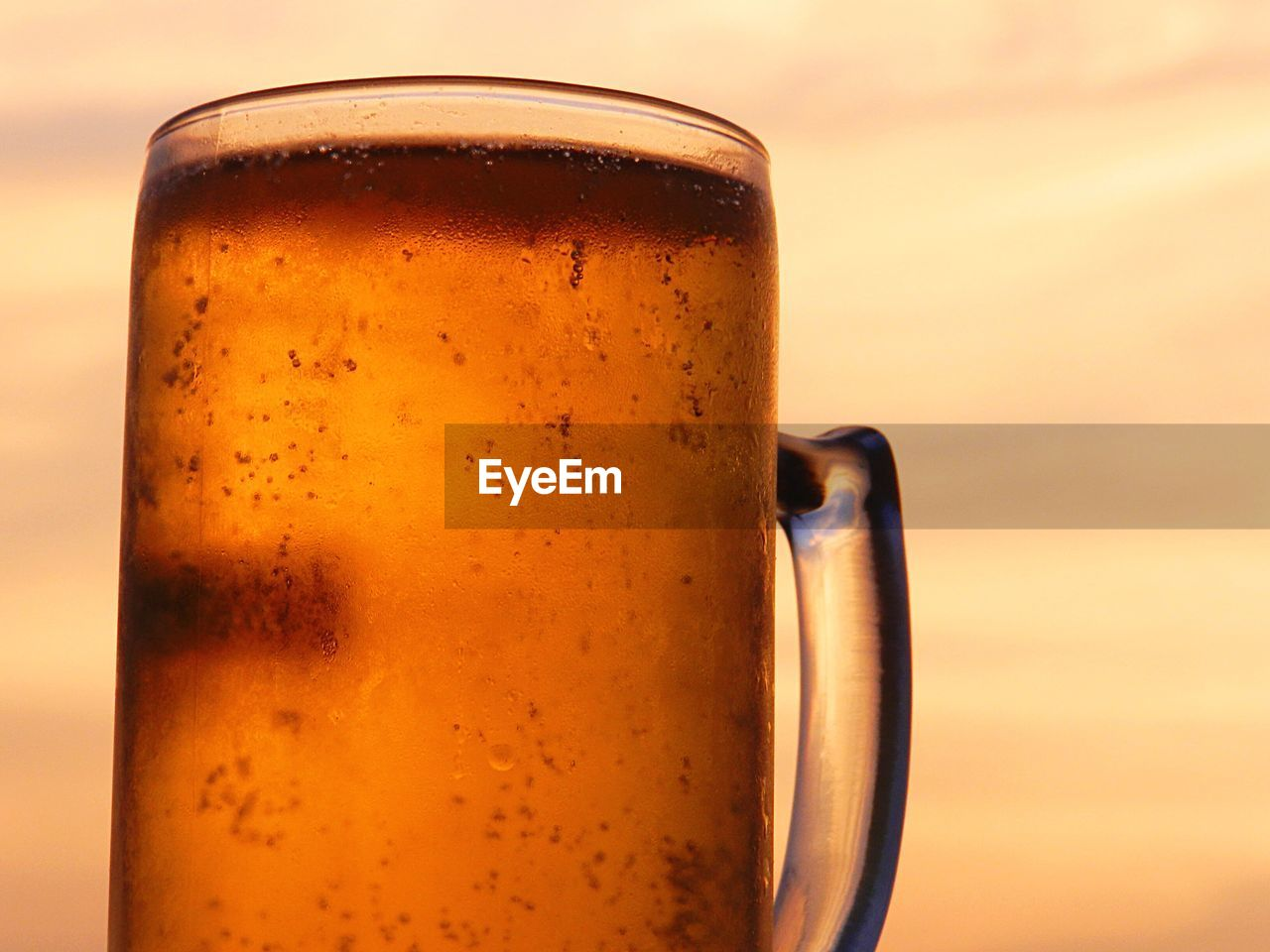 Low angle view of beer glass against sky
