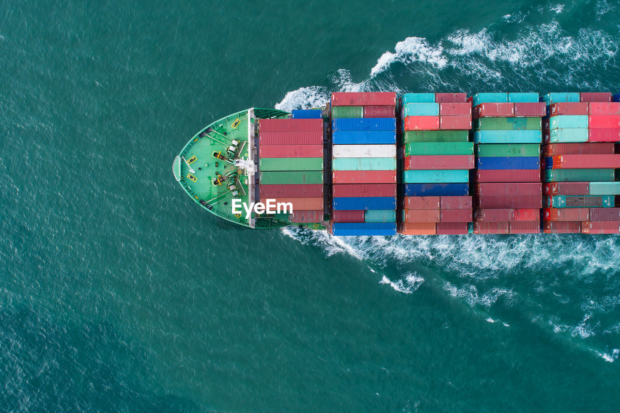 HIGH ANGLE VIEW OF SHIP IN SEA